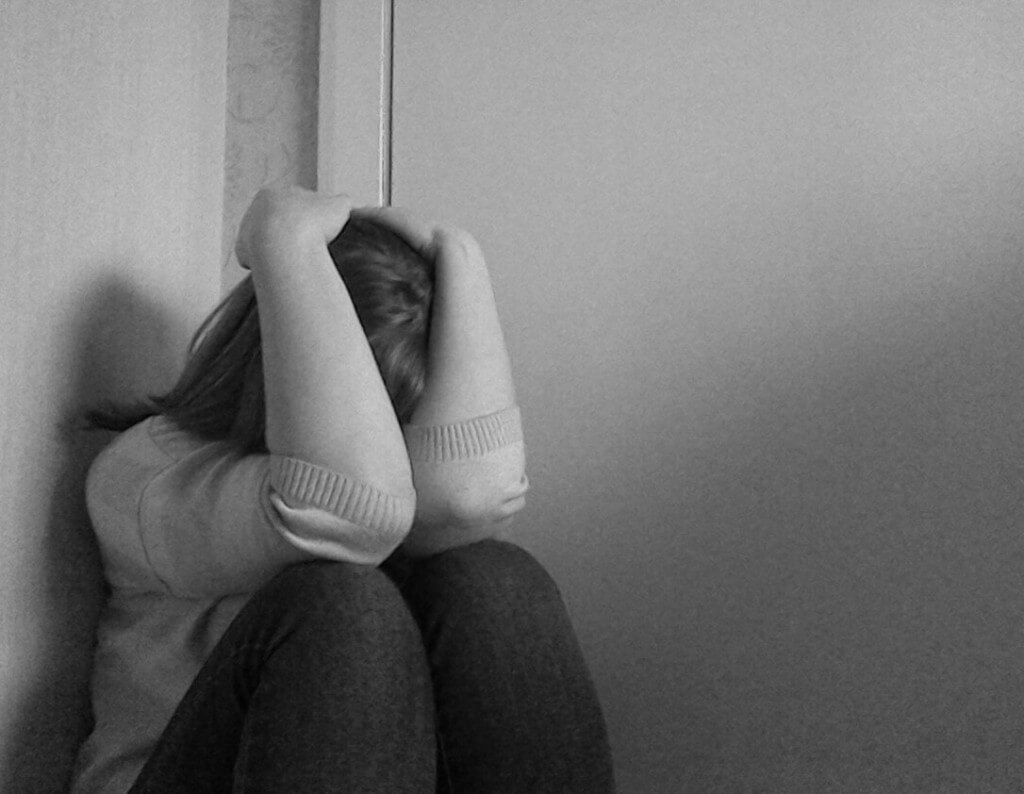 depressed woman in the corner